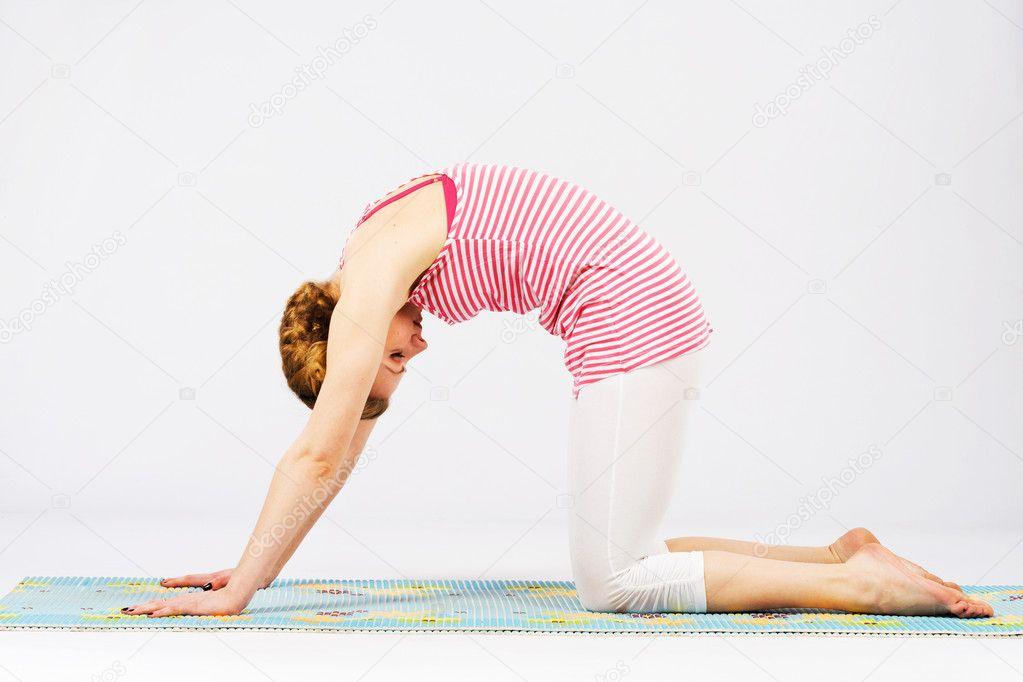 depositphotos_11445319-stock-photo-beautiful-woman-doing-cat-yoga
